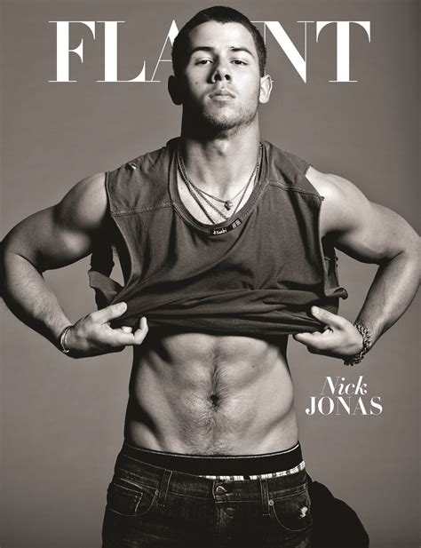 Nick Jonas wears jewelry and not much else on Flaunt's